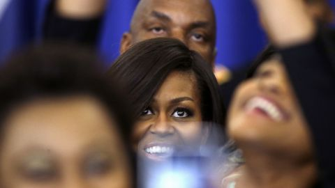 Michelle Obama, the first lady of the United States, poses for a selfie on Monday, April 20, after speaking at a New Orleans event honoring efforts to help homeless veterans.