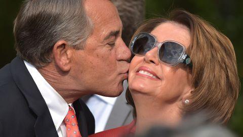 House Speaker John Boehner kisses House Minority Leader Nancy Pelosi during a reception in the Rose Garden of the White House on April 21, 2015.