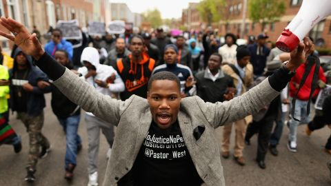 Hundreds of demonstrators march toward the Baltimore Police Western District station on April 22.