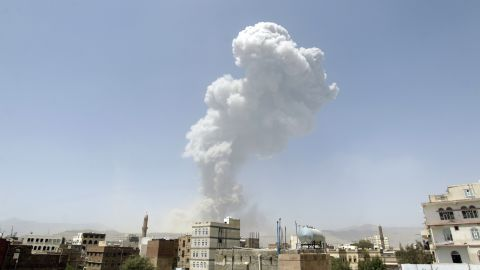 """Smoke billows from the Fajj Attan Hill following a reported airstrike by the Saudi-led coalition on an army arms depot, now under Huthi rebel control, on April 20, 2015, in Sanaa. The UN this week called the humanitarian crisis in Yemen one of the """"largest and most complex in the world."""""""