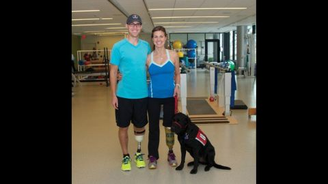 """<strong>Patrick Downes</strong> and <strong>Jessica Kensky Downes </strong>met when they were interns on Capitol Hill. She lost both legs and was pushed into court in a wheelchair. Her aide dog, Rescue, lay beside her as she testified. """"I remember being happy, I remember feeling sunlight on my face. I remember feeling free."""" And then the bomb went off. Because she is a nurse, she focused on saving her husband. His foot and part of his leg were hanging by a thread. She remembers screaming, and not being able to hear anything. This photo was taken before she decided to amputate her second leg in January. """"I wanted to paint my toenails and put my feet in the sand. I wanted all of those things, and to lose my second leg was a gut-wrenching decision."""""""