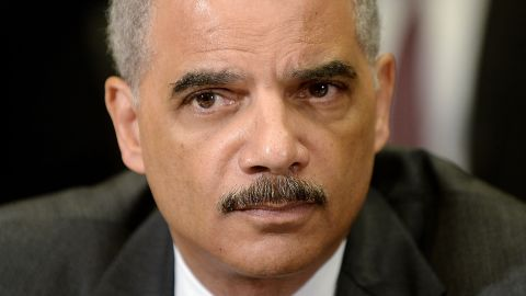 U.S. Attorney General Eric Holder attends a meeting with the My Brother's Keeper Task Force to receive a 90-day report on its progress in the Roosevelt Room of the White House in May 2014. Holder's resignation was announced in September 2014, but his replacement, Loretta Lynch, was not confirmed by the Senate until April 23, 2015.