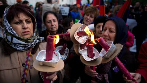 Armenian women hold torches during a march in Jerusalem, Israel, on Thursday, April 23, commemorating the 100th anniversary of what many call the first genocide of the 20th century. In 1915 the Ottoman Empire began the systematic extermination of its Armenian minority population. An estimated 1.5 million Armenians died in the massacre .