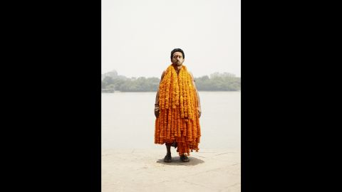 """The flowers Sanju Joshi carries are common in India. """"I really like (Joshi's) picture because (the sellers) carry the flowers like it is a dress. You should see when they walk through the flower market, it's almost like (the flowers are) all alive,"""" Hermann said."""