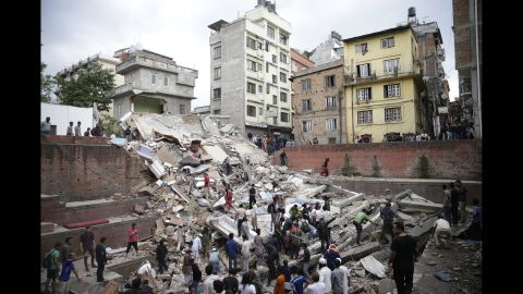 People search for survivors stuck under the rubble of a destroyed building in Kathmandu.