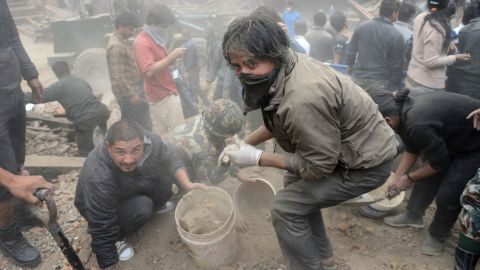 Rescuers clear rubble in Kathmandu's Basantapur Durbar Square on  April 25.