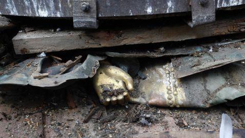The hand of a statue is seen under debris in Basantapur Durbar Square in Kathmandu.