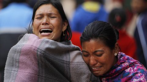 Family members break down on April 26 during the cremation of a loved one killed inBhaktapur.