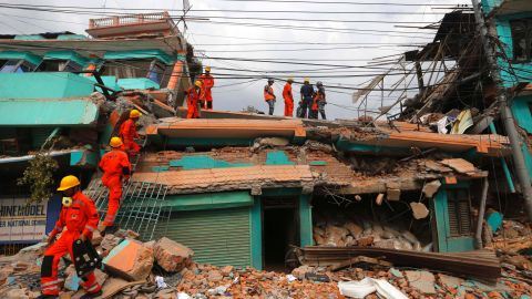 Members of India's National Disaster Response Force look for survivors in Kathmandu on April 26.