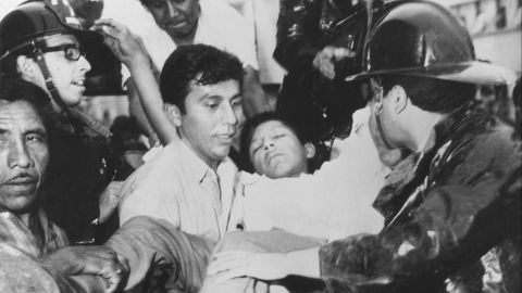 One of the wounded is helped into an ambulance after the earthquake in Chimbote Peru on May 31, 1970.
