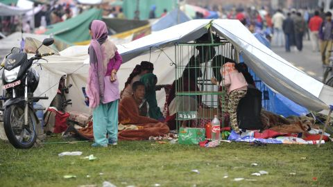 People rest in temporary shelters in Kathmandu on April 27.