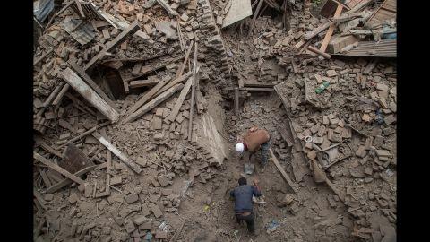 Men clear debris in Bhaktapur on April 26.