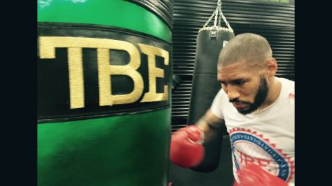 """After sparring, Theophane moves to the heavy bag. """"I'll normally do 20 minutes on the heavy bag without a break,"""" Theophane tells CNN. The moniker """"TBE"""" on the bag reflects Mayweather's self-dubbed nickname of """"The Best Ever."""""""