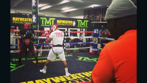 """""""When he hits the body, block then bam, uppercut, bam uppercut!"""" coach Nate Jones says to the former British light welterweight champion as he maneuvers his opponent into the corner of the ring."""