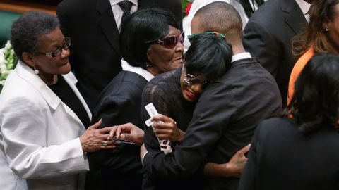 Freddie Gray's twin sister, Fredericka Gray, is embraced by family members and supporters during her brother's funeral.