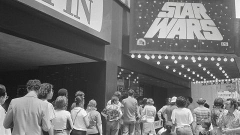 """""""Star Wars"""" was a phenomenon upon release in May 1977, with lines around the block (in the days when theaters were largely located on city blocks). Here, people line up in New York to see the film, which soon became the highest-grossing film of all time -- a record it held until """"E.T."""" took its place five years later."""
