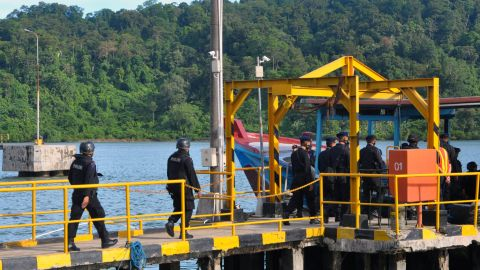 An Indonesian police firing squad boards a boat in Cilacap, Indonesia, to cross to the maximum security prison on Nusa Kambangan island on Tuesday, April 28, ahead of the execution of  drug convicts.