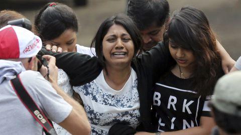 Brintha Sukumaran, center, sister of death row prisoner Myuran Sukumaran, cries upon arrival at the ferry port in Cilacap on April 28.