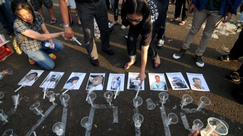 Protestors light candles outside the Presidential Palace in Jakarta on April 28 for those scheduled to be executed.