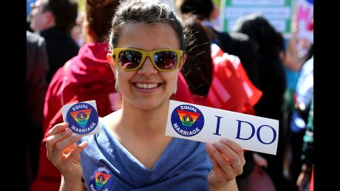 McKenna Inskeep hands out stickers in support of marriage equality outside the Supreme Court.