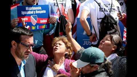"""A group against same-sex marriage prays in an """"appeal to heaven"""" outside the Supreme Court."""