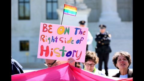 Catherine Quinn of Detroit holds up her sign supporting same-sex marriage outside the Supreme Court.