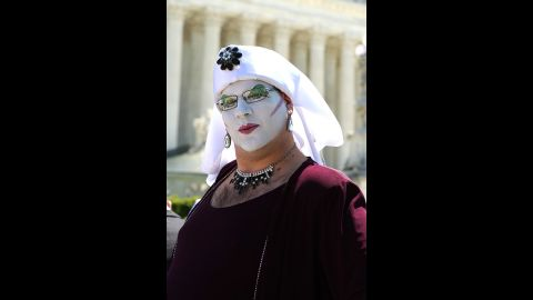 """Senior Novice Sister Sedusa Poly Tishun shows off her face paint outside the Supreme Court. """"We're here raising up our voices and our glitter in shouts of joy in support of marriage equality,"""" Tishun said."""