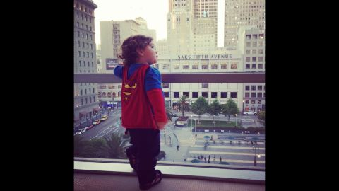 """Keren Espinoza shot <a href=""""http://ireport.cnn.com/docs/DOC-978667"""">this photo</a> of her then 19-month-old son, Jaden, standing on the seventh floor of Macy's in San Francisco last year. The Superman shirt and cape is one of her favorite outfits to put on him. """"I love to see him run and swing at the park; he looks like his cape really makes him fly."""""""