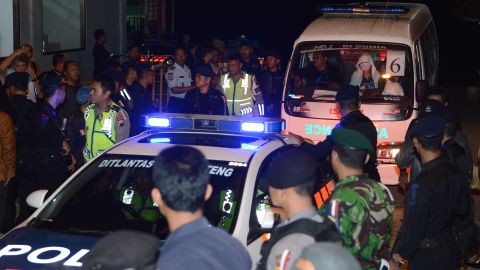 """A police car escorts an ambulance carrying the coffin bearing the body of one of the eight executed drug convicts as it arrives in Nusakambangan port in Cilacap after the executions at Nusakambangan maximum security prison island on Wednesday, April 29. <a href=""""http://edition.cnn.com/2015/04/28/asia/indonesia-firing-squad-executions/"""" target=""""_blank""""> Indonesia  executed eight convicted drug smugglers -- including two of the so-called """"Bali Nine"""" -- the Reuters news agency reported, citing local media</a>, despite a firestorm of international criticism and last-ditch pleas by the condemned prisoners' families."""