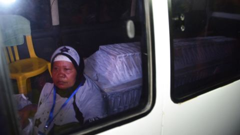 A coffin bearing the body of one of the executed is transported in an ambulance escorted by an unidentified woman on April 29.