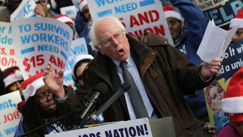 Sanders speaks to low-wage federal contract workers during a protest where the workers demanded presidential action to win an increase to $15 an hour wage on December 4, 2014, in Washington, D.C.