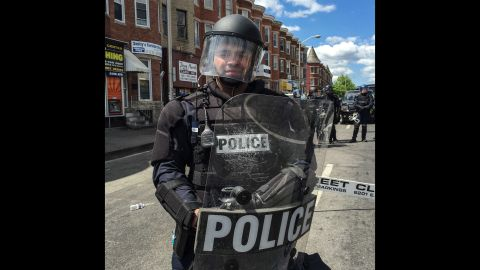 """When his class was there, riot officers restrained and carried away someone, Larson says.  The crowd scattered in fear and then regrouped cautiously. Police put a sniper team on a nearby roof and a helicopter buzzed above.  """"My students no longer felt safe and we decided to leave as a group,"""" he says.  """"My heart was very heavy on leaving."""""""