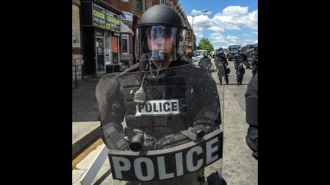 """Police gave no """"verbal or non-verbal response to my photographing them, which I took as implied consent,"""" Larson says."""