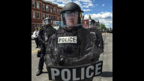 """In all, there were """"27 officers standing shoulder to shoulder in full riot gear,"""" Larson says."""