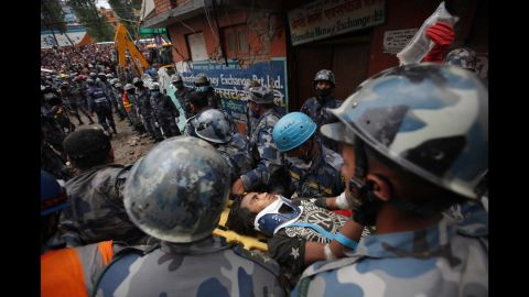 """A teenage boy gets rushed to a hospital April 30 <a href=""""http://edition.cnn.com/2015/04/30/asia/nepal-earthquake/index.html"""">after being rescued from the debris of a building</a> in Kathmandu days after the earthquake."""