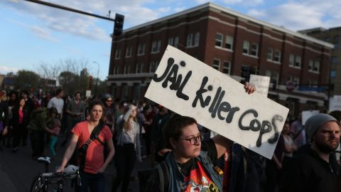 People in Minneapolis march during a rally on April 29.