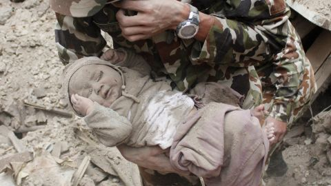 The newspaper that provided photographs of the baby's rescue says the Nepalese army initially left the site, thinking the baby had not survived. Hours later when the infant's cries were heard, soldiers came back and rescued him.