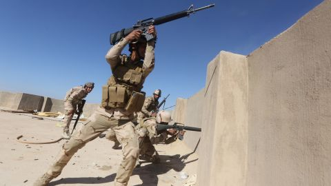 Iraqi soldiers fire their weapons toward ISIS group positions in the Garma district, west of the Iraqi capital of Baghdad, on Sunday, April 26. Pro-government forces said they had recently made advances on areas held by Islamist jihadists.
