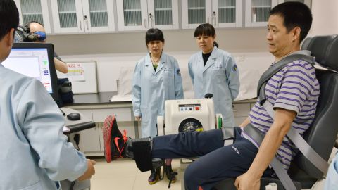 Nie undergoes an isokinetic muscle test.