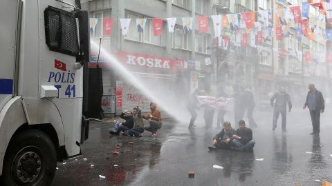 """Police use water cannons on May Day demonstrators in Istanbul, Turkey, on Friday, May 1. Clashes erupted between police and protesters, who defied a government ban  on marching to Taksim Square. Rallies around the world marked <a href=""""http://www.cnn.com/2013/09/03/world/may-day-fast-facts/index.html"""">May Day</a>, referred to as International Workers' Day in many countries."""