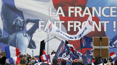 France's far-right National Front leader Marine Le Pen, center, delivers a speech during the May Day march in Paris.