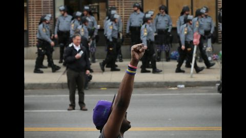 A demonstrator celebrates in Baltimore the charges were announced on May 1.