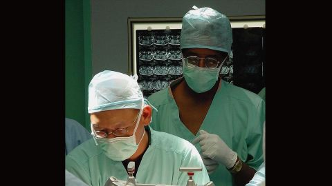 Carson observes the start of neurosurgery proceedings at the Raffles Hospital in Singapore on July 6, 2003. Carson and Dr. Keith Goh, left, performed a complex operation that was unsuccessful to separate 29-year-old twins Ladan And Laleh Bijani, who were joined at the head.