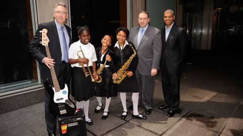 Huckabee (second from right), students and others attend the May 14, 2010, NAMM Foundation Wanna Play Fund event at Fox News studios in New York. The initiative, in conjunction with the VH1 Save the Music Foundation, includes instrument donations.