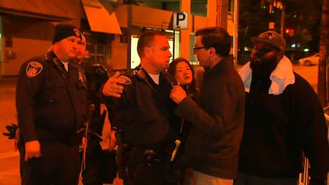 A Baltimore police officer confronts CNN's Miguel Marquez over where the media can stand during curfew.