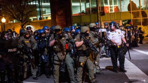 Police in riot gear enforce a 10 p.m. curfew and clear Baltimore streets of protesters and media on Friday, May 1.