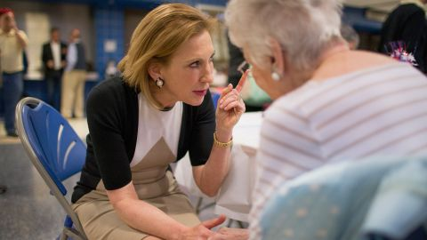 Fiorina greets guests at the Johnson County Republicans Spaghetti Dinner at Clear Creek Amana High School on April 24, 2015, in Tiffin, Iowa.
