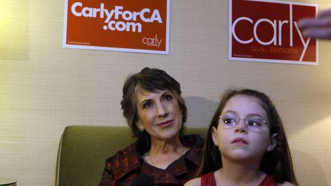 Fiorina, left, watches election results with granddaughter Kara Tribby, 7, in her hotel room at the Hyatt Regency Irvine, November 2, 2010, in Irvine, California.