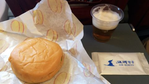 The in-flight meal on Air Koryo is a burger and a glass of North Korean beer.
