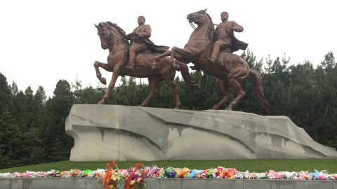 Twin statues honor the late leaders of North Korea Kim Il Sung and Kim Jong Il. Visitors are routinely taken here to pay their respects and lay flowers at the statue, Saturday, May 2, 2015.